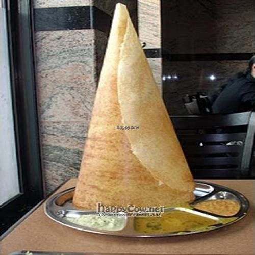 """Photo of Komala's Restaurant - Main Branch  by <a href=""""/members/profile/Peace%20..."""">Peace ...</a> <br/>This fancy little tall hat is special dosai known as Cone Dosai (S$3.20)! <br/> March 19, 2010  - <a href='/contact/abuse/image/9970/4050'>Report</a>"""