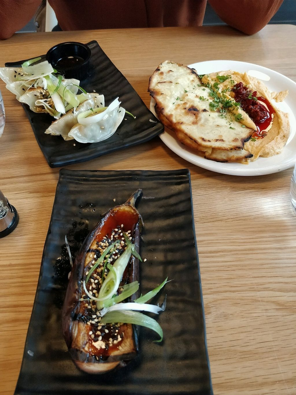 "Photo of Mildred's Dalston  by <a href=""/members/profile/Plumesworld"">Plumesworld</a> <br/>Miso glazed aubergine, gyoza, flat bread and houmous - all vegan <br/> August 31, 2017  - <a href='/contact/abuse/image/99713/299359'>Report</a>"