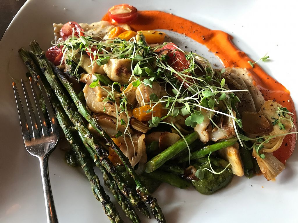 "Photo of Harvest Seasonal Grill & Wine Bar  by <a href=""/members/profile/Dveg"">Dveg</a> <br/>Vegan raviolis!  Sign me up!  Mushrooms, artichokes, subtly blissful! <br/> April 2, 2018  - <a href='/contact/abuse/image/99929/379984'>Report</a>"