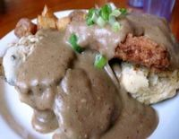 """Photo of Vita Cafe  by <a href=""""/members/profile/quarrygirl"""">quarrygirl</a> <br/>sloppy biscuit sandwich: fried tofu, faux turkey, vegan cheese and gravy between a vegan biscuit served with potatoes <br/> December 27, 2011  - <a href='/contact/abuse/image/2434/190593'>Report</a>"""
