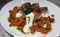 """Photo of Vaust Braugaststatte  by <a href=""""/members/profile/WolfgangGrabolle"""">WolfgangGrabolle</a> <br/>Hearty Sauerkraut Goulash with soy cubes and colorful strips of pepper, topped with cream, served with homemade spent grain  dumplings  <br/> January 21, 2014  - <a href='/contact/abuse/image/32229/62902'>Report</a>"""