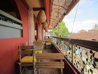 """Photo of Earth Cafe and Market - Ubud  by <a href=""""/members/profile/lindn"""">lindn</a> <br/>Outdoor eating area <br/> June 1, 2014  - <a href='/contact/abuse/image/32487/71233'>Report</a>"""