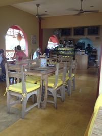 """Photo of Earth Cafe and Market - Ubud  by <a href=""""/members/profile/ole_ersson"""">ole_ersson</a> <br/>The restaurant upstairs. It's a bright, airy atmosphere with great views of the nearby buildings and gardens. Bamboo and wood furniture with yellow foam cushions. Very comfy <br/> December 3, 2014  - <a href='/contact/abuse/image/32487/87169'>Report</a>"""