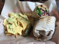 """Photo of VO2 Vegan Cafe  by <a href=""""/members/profile/CarleeBusby"""">CarleeBusby</a> <br/>Vegan Banh mi sandwhich made into a wrap, with a side of vegan nachos <br/> August 29, 2017  - <a href='/contact/abuse/image/34862/298748'>Report</a>"""