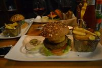 """Photo of Zombie Bar  by <a href=""""/members/profile/DaviaTaylor"""">DaviaTaylor</a> <br/>The burger I got, not entirely sure if everything on the burger was vegan besides the patty because they served it with a side of non-vegan sauce, which makes me think the onion rings could have a non-vegan batter.  <br/> October 28, 2015  - <a href='/contact/abuse/image/36777/122945'>Report</a>"""