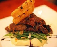 """Photo of Candle 79  by <a href=""""/members/profile/quarrygirl"""">quarrygirl</a> <br/>Black Pepper & Balsamic Grilled Seitan: sauteed haricots verts, leeks, almonds, cornmeal crusted onion rings, celeriac puree <br/> December 26, 2011  - <a href='/contact/abuse/image/4849/189315'>Report</a>"""