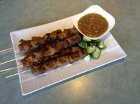 Photo of Ambrosia Veggie House  by Ambrosia Veggie <br/>Satay Skewers <br/> August 12, 2014  - <a href='/contact/abuse/image/48757/76809'>Report</a>