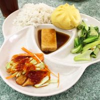 """Photo of Water Lily Restaurant  by <a href=""""/members/profile/whollyvegan"""">whollyvegan</a> <br/>vegan chick'n, tofu, book choy, & steamed bun set. comes with cold herbal tea.  <br/> August 29, 2017  - <a href='/contact/abuse/image/7264/298539'>Report</a>"""