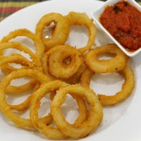 """Photo of La Pasta  by <a href=""""/members/profile/Cambobby"""">Cambobby</a> <br/>BAKED ITALIAN ONION RINGS Onion rings, baked and expertly seasoned with Italian seasoning and a hint of chili pepper <br/> December 10, 2016  - <a href='/contact/abuse/image/83737/198833'>Report</a>"""
