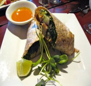 """Photo of Caravan of Dreams  by <a href=""""/members/profile/From%20A%20to%20Vegan"""">From A to Vegan</a> <br/>Breakfast Burrito with potatoes, sautéed kale, guacamole, smoked tofu, chile de árbol <br/> August 16, 2011  - <a href='/contact/abuse/image/2261/210682'>Report</a>"""